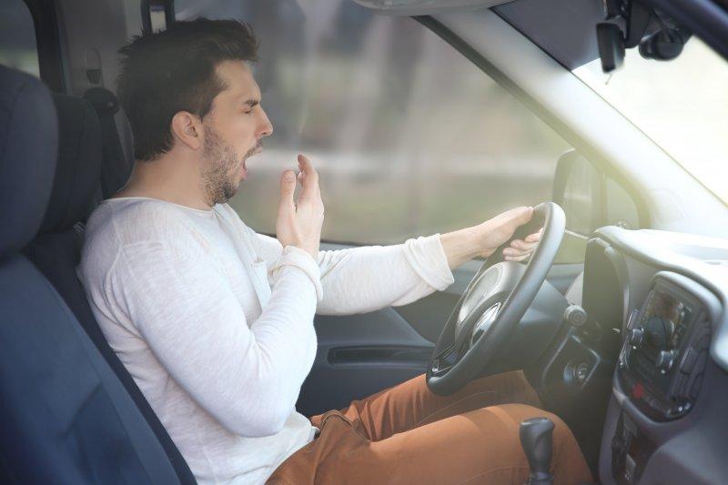man yawning while driving due to sleep apnea in Dunwoody